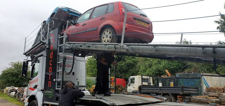 Car being loaded onto truck